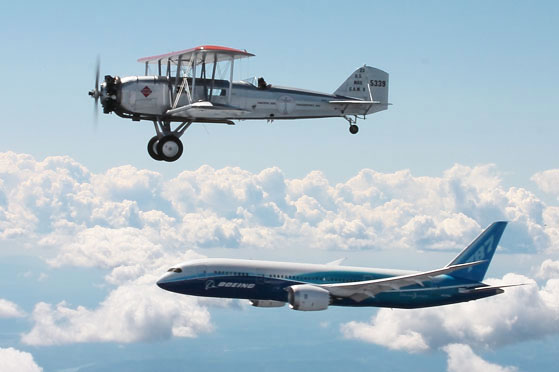A Boeing Model 40C flies in formation with a new Boeing Dreamliner