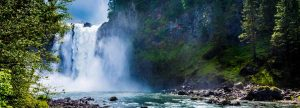 Water pours over Snoqualmie Falls, part of Washington State's power grid