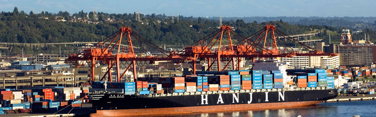 A Hanjin container ship is loaded at a Port of Seattle facility