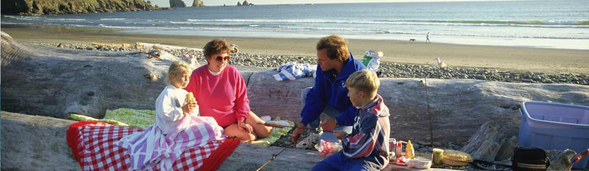 A family enjoys a picnic on a Washington State beach