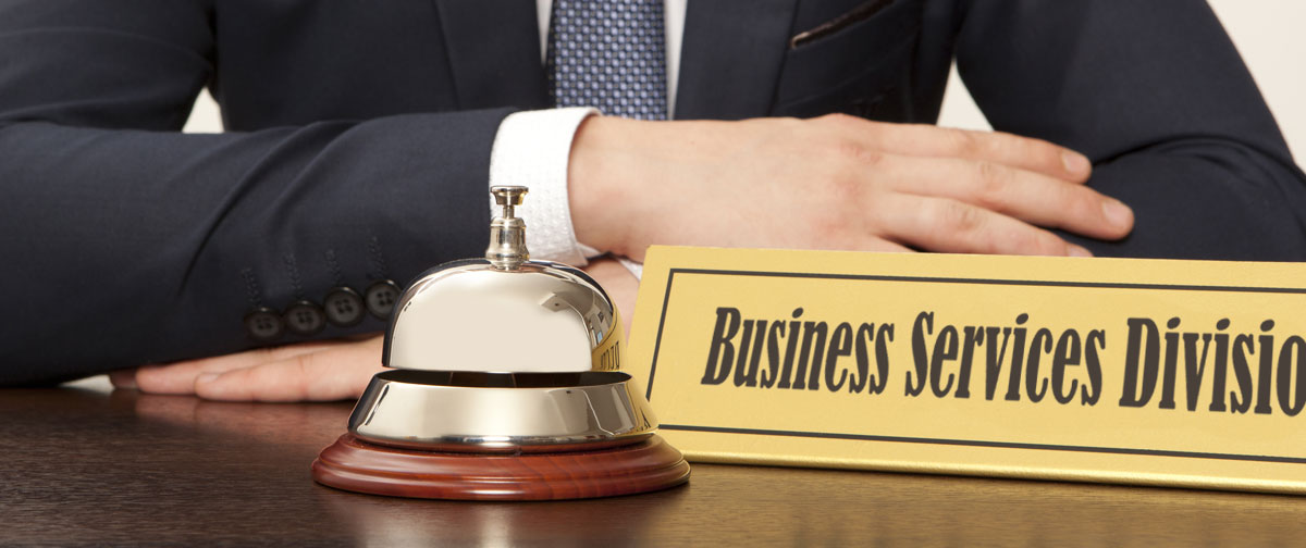 A nameplate with the words Business Services appears with a bell to ring