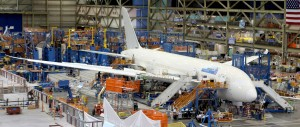 Workers put the finishing touches to a Boeing 787 Dreamliner