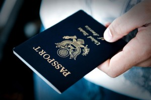 A man holds a passport in his hand