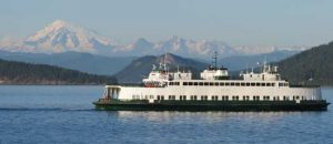 A Washington State ferry passes the Olympic Mountains