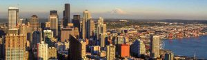 Aerial view of downtown Seattle and Mount Rainier in the distance.
