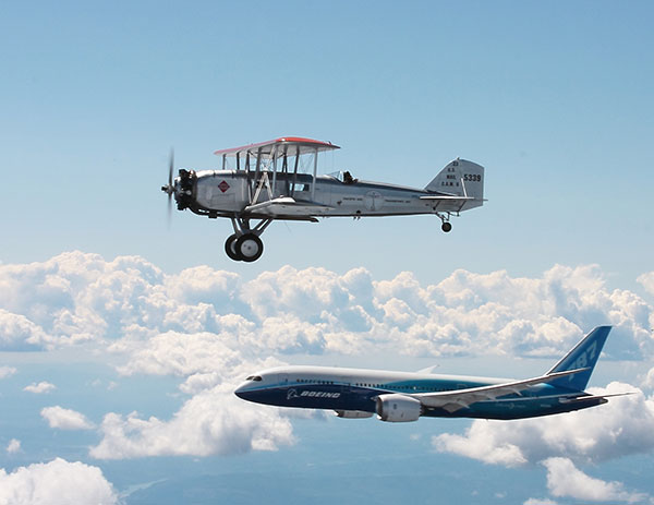 Boeing's first passenger aircraft, the Model 40, flies in formation with the Boeing 787 Dreamliner