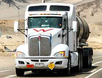A Kenworth truck, part of Paccar's transportation network, heads down the highway.