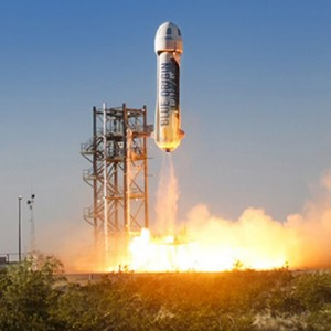 A Blue Origin rocket lifts off from its pad during a test