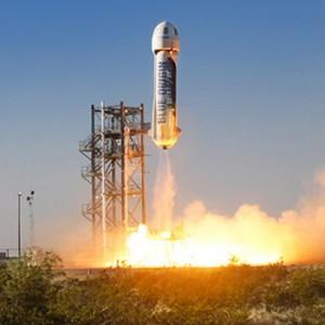 Blue origin rocket launches into space.