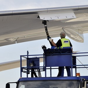 Fuel made of forest byproducts is loaded into the fuel tanks of a Boeing 787