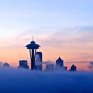The Seattle skyline, partially obscured by fog