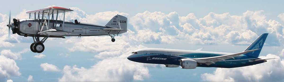 Washington's century of aerospace leadership on display in the air with Boeing's Model 40 and 787 Dreamliner flying in formation.