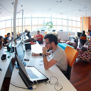 Software developers on deadline in a spacious open office