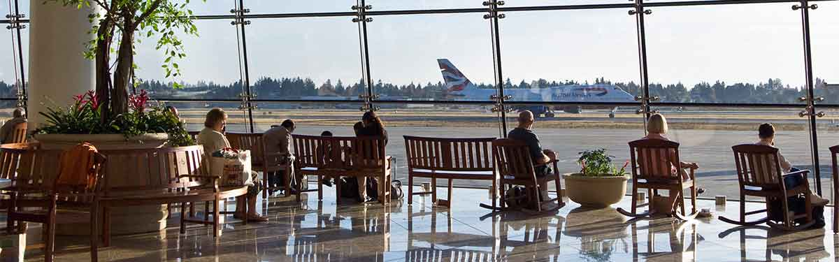 Passengers enjoy a bite to eat at Sea Tac as they watch planes ready for takeoff