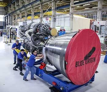 Workers roll out the first BE-4 engine in the Blue Origin Factory in Washington State