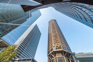 Seattle skyscrapers soar above a Seattle street corner.