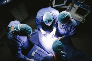 Surgeons begin a surgical procedure in a hospital.
