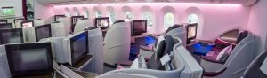 The interior cabin of business class on a 787 Dreamliner.