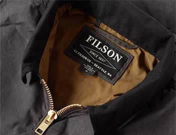 The collar of a Filson brand jacket, showing the company's label.