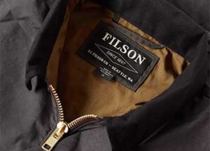A shot of a Filson brand jacket with its label on the collar.