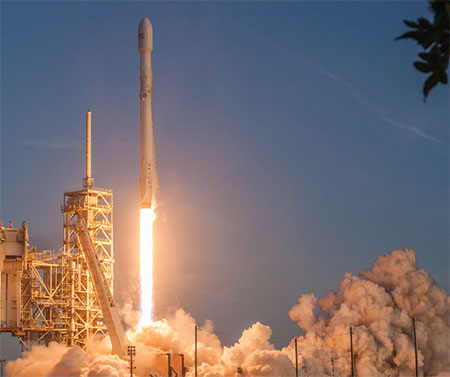 A Falcon 9 lifts off from the pad, sending Space X satellites into orbit.