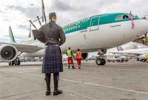 A bag piper welcomes the first scheduled Seattle to Dublin flight to Sea-Tac International Airport