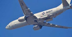 The P-8 Poseidon anti-submarine plane built by Boeing flies overhead.