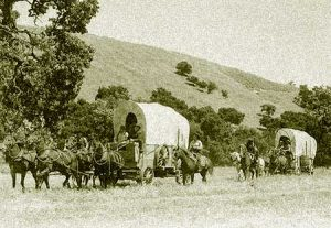 A wagon train heads for Naches Pass, an arduous journey that is the essence of Washington's pioneer spirit.