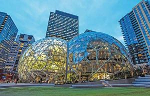 Amazon's Spheres filled with foliage in the foreground with the company's Doppler building behind.