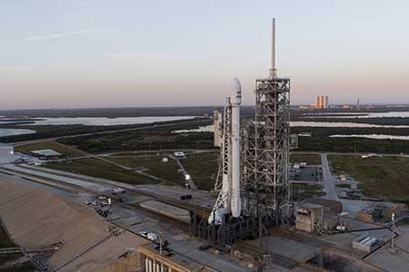 A Falcon rocket prepares for liftoff at Cape Canaveral