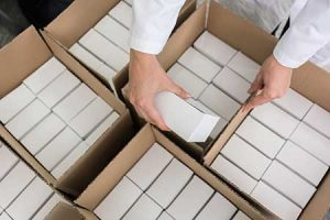 An employee boxes product up for exporting using Washington's STEP grant.