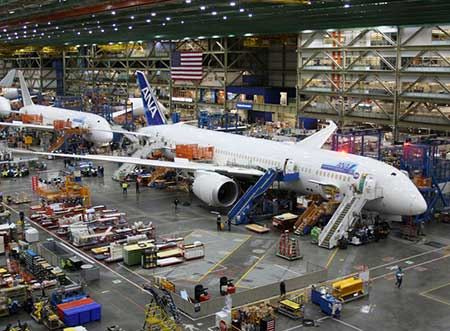Boeing Dreamliners roll through the assembly plant in Everett, Washington