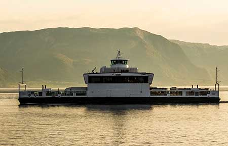 An electrified ferry crosses a fjord in Norway.