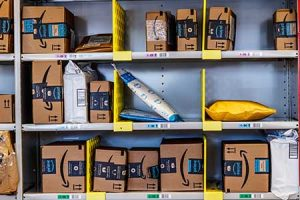 A bunch of Amazon boxes await delivery in a warehouse.