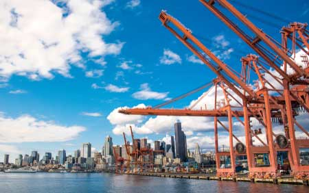 Seattle's port is lined with large cranes to handle international shipments.