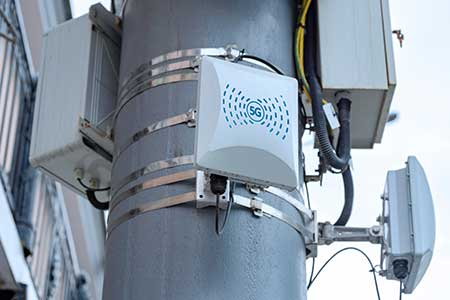A 5G network repeater on a power pole.