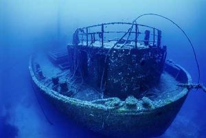 A shipwreck rises eerily from the ocean floor.
