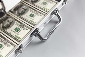 A briefcase full of bundles of American dollars.
