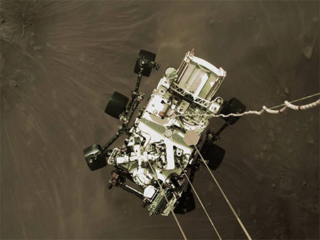The Perseverance rover is lowered down to the surface of Mars by Aerojet thrusters.